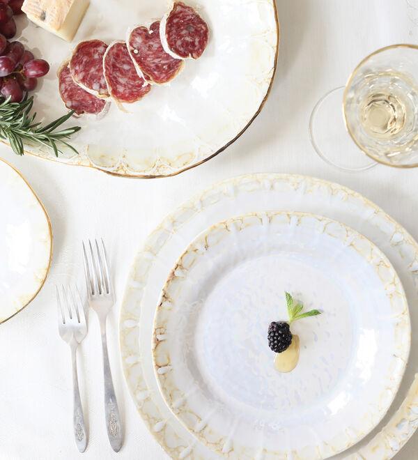 Tabletop & Bar. Stylish dinnerware, stemware, serveware and more. Image of dinnerware and flatware.