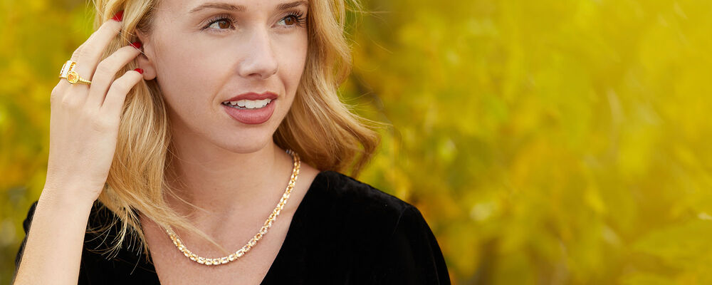 citrine for november. give or wear this meaningful birthstone. model wearing citrine jewelry