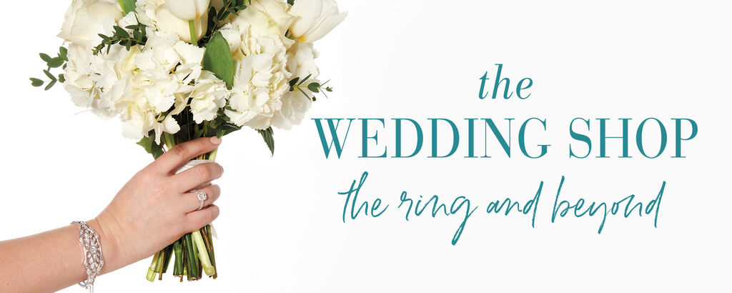 The Wedding Shop. The ring and beyond. White flowers wrapped strand of pearls.