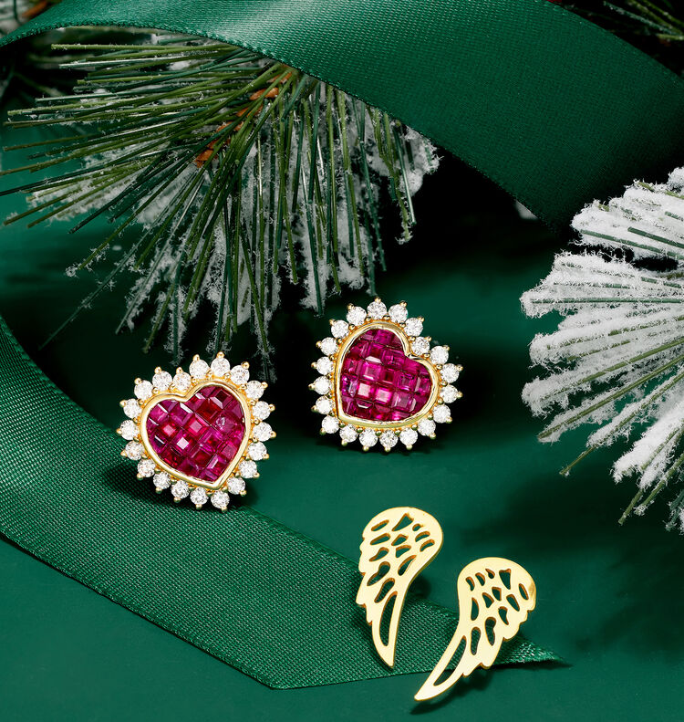 Gifts With Meaning. Image Featuring two Earrings, Gemstone and Diamond and Gold Wings on green background