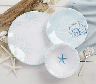 Summer Ready. Make your home a tranquil oasis. Shop now. Image of seashell dinnerware.
