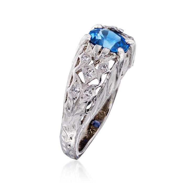 C. 1990 Vintage 1.20 Carat Sapphire and .12 ct. t.w. Diamond Ring in Platinum