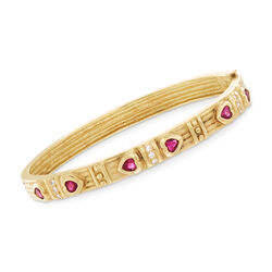 "C. 1990 Vintage .90 ct. t.w. Ruby and .20 ct. t.w. Diamond Heart Bangle Bracelet in 18kt Yellow Gold. 7"", , default"