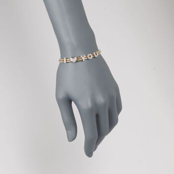 "C. 1980 Vintage .75 ct. t.w. Diamond ""I Love You"" Bracelet in 14kt Two-Tone Gold. 7"""