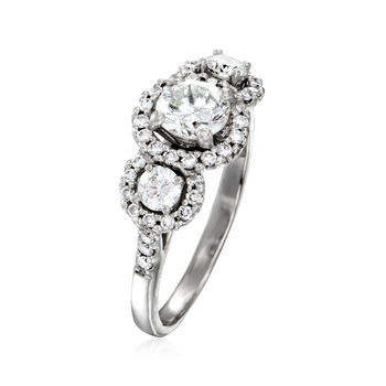 C. 1990 Vintage 1.45 ct. t.w. Diamond Three-Stone Halo Ring in 14kt White Gold. Size 7