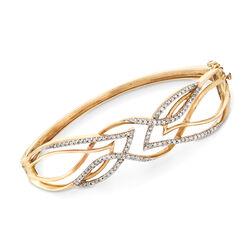C. 1970 Vintage .85 ct. t.w. Diamond Openwork Crisscross Bangle Bracelet in 10kt Yellow Gold, , default