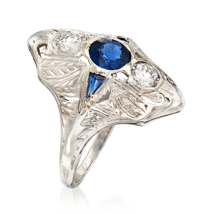 C. 1990 Vintage .60 Carat Sapphire and .40 ct. t.w. Diamond Ring with Synthetic Sapphire Accents in 18kt White Gold