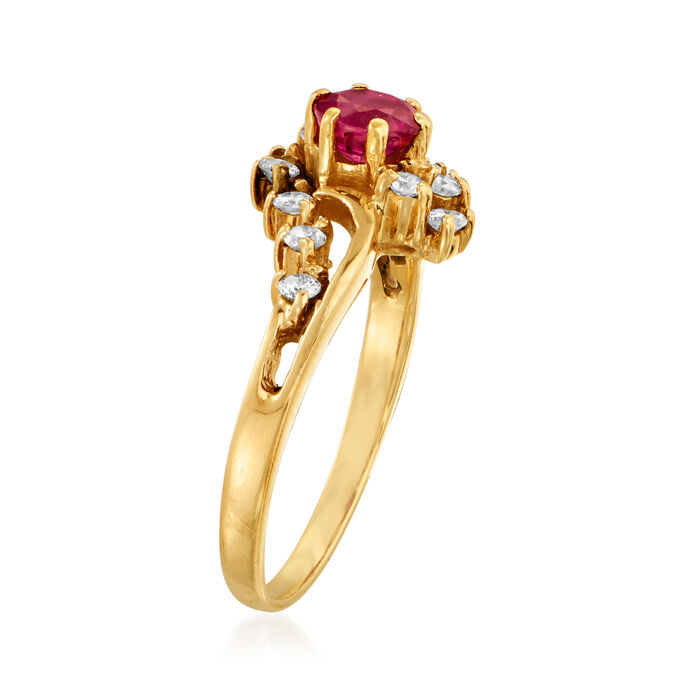 C. 1990 Vintage .50 Carat Ruby and .35 ct. t.w. Diamond Ring in 14kt Yellow Gold