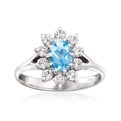 C. 1980 Vintage .58 Carat Aquamarine and .50 ct. t.w. Diamond Halo Ring in 14kt White Gold