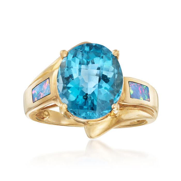 C. 1990 Vintage 6.50 Carat Blue Topaz Ring with Synthetic Opal in 10kt Yellow Gold. Size 7, , default