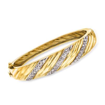 C. 1980 Vintage .75 ct. t.w. Diamond Striped Bangle Bracelet in 14kt Yellow Gold