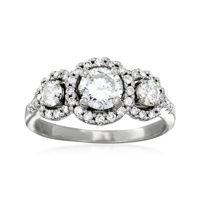 C. 1990 Vintage 1.45 ct. t.w. Diamond Three-Stone Halo Ring in 14kt White Gold