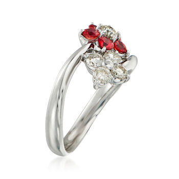 C. 1990 Vintage .68 ct. t.w. Orange Sapphire and .55 ct. t.w. Diamond Flower Bypass Ring in Platinum. Size 6.5