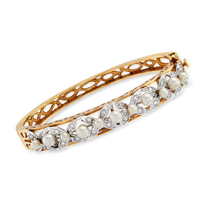 C. 1970 Vintage 3.5-4.5mm Cultured Pearl and .75 ct. t.w. Diamond Bangle Bracelet in 14kt Two-Tone Gold