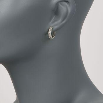 """.50 ct. t.w. Diamond Huggie Hoop Earrings in 14kt White Gold. 1/2"""""""