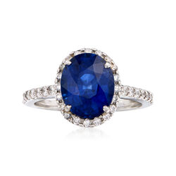 C.1990 Vintage 4.50 Carat Sapphire and .55 ct. t.w. Diamond Halo Ring in Platinum, , default