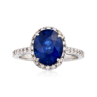 C.1990 Vintage 4.50 Carat Sapphire and .55 ct. t.w. Diamond Halo Ring in Platinum, , default