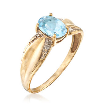 C. 1980 Vintage .90 Carat Blue Topaz Ring with Diamond Accents in 10kt Yellow Gold. Size 7, , default