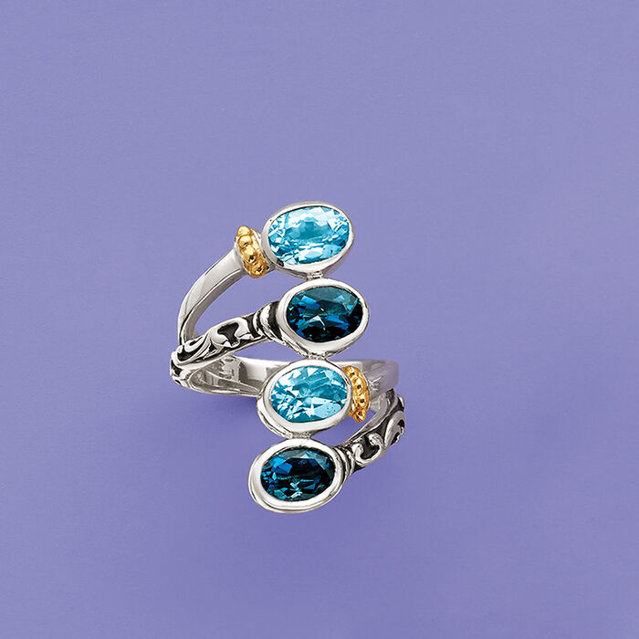 3.70 ct. t.w. Swiss and London Blue Topaz Bypass Ring with 14kt Yellow Gold in Sterling Silver