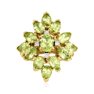 C. 1980 Vintage 6.23 ct. t.w. Peridot and .11 ct. t.w. Diamond Cluster Ring in 18kt Yellow Gold