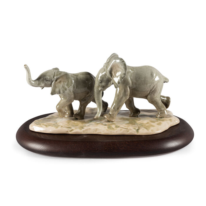 Lladro Porcelain Elephant Figurine: Following the Path
