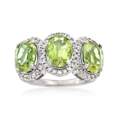 6.00 ct. t.w. Peridot and .50 ct. t.w. White Topaz Three-Stone Ring in Sterling Silver, , default