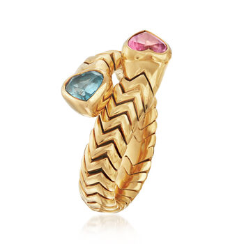 C. 1990 Vintage Bulgari .60 Carat Blue Topaz and .50 Carat Pink Tourmaline Heart Bypass Ring in 18kt Yellow Gold. Size 7.5