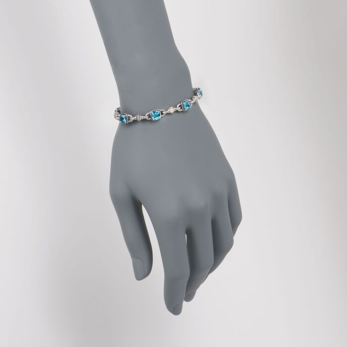 6.05 ct. t.w. Blue Topaz Bracelet in Sterling Silver and 14kt Yellow Gold