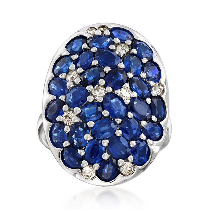 C. 1990 Vintage 6.75 ct. t.w. Oval Sapphire and .35 ct. t.w. Diamond Cluster Ring in 18kt White Gold. Size 7