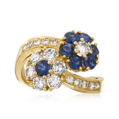 C. 1990 Vintage 1.53 ct. t.w. Sapphire and 1.26 ct. t.w. Diamond Flower Bypass Ring in 18kt Yellow Gold