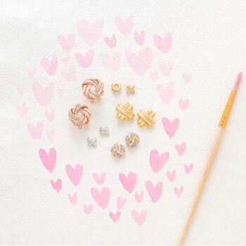 .25 ct. t.w. Diamond Swirl Knot Earrings in 14kt Yellow Gold