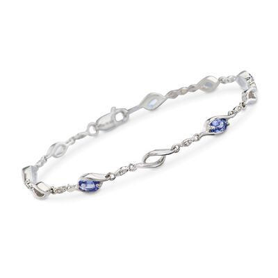 1.20 ct. t.w. Tanzanite Swirl Link Bracelet with White Topaz Accents in Sterling Silver