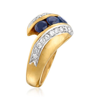C. 1980 Vintage .90 ct. t.w. Sapphire and .50 ct. t.w. Diamond Bypass Ring in 18kt Yellow Gold. Size 7.25