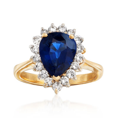 C. 1980 Vintage 2.40 Carat Sapphire and .51 ct. t.w. Diamond Ring in 14kt Yellow Gold