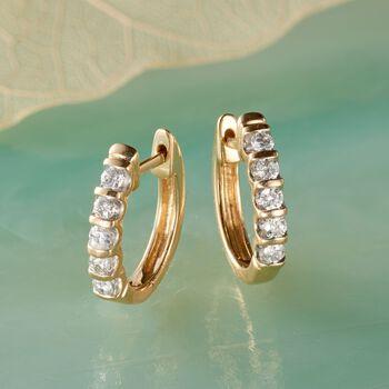 """.25 ct. t.w. Diamond Huggie Hoop Earrings in 14kt Yellow Gold. 1/2"""""""