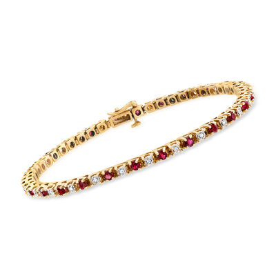 C. 1990 Vintage 2.08 ct. t.w. Ruby and .26 ct. t.w. Diamond Tennis Bracelet in 14kt Yellow Gold