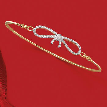 ".15 ct. t.w. Diamond Bow Bangle Bracelet in 14kt Yellow Gold. 7"", , default"