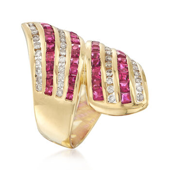 C. 1990 Vintage 2.44 ct. t.w. Ruby and .70 ct. t.w. Diamond Bypass Ring in 18kt Yellow Gold. Size 7.5