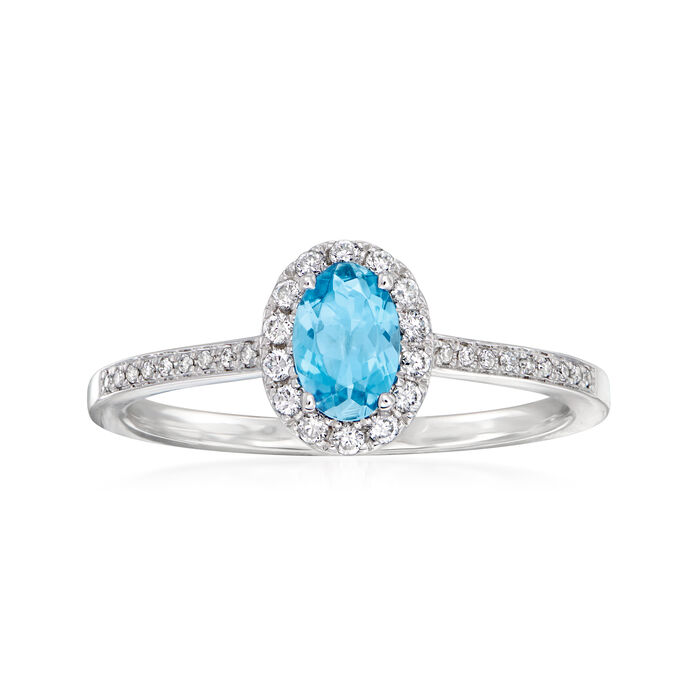 C. 1990 Vintage .27 Carat Aquamarine and .18 ct. t.w. Diamond Halo Ring in 14kt White Gold