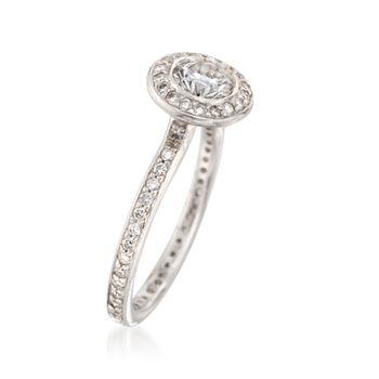 C. 2000 Vintage .75 ct. t.w. Diamond Halo Ring in Platinum. Size 4.5