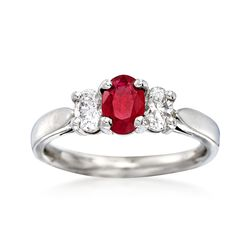 C. 1990 Vintage .55 Carat Ruby and .55 ct. t.w. Diamond Three-Stone Ring in Platinum. Size 7, , default