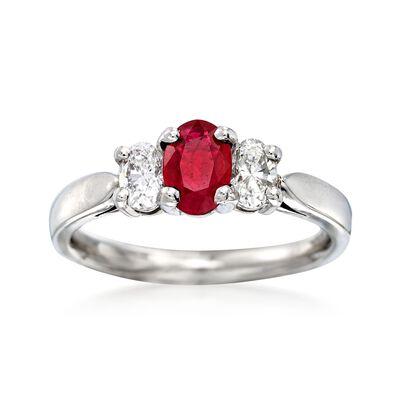 C. 1990 Vintage .55 Carat Ruby and .55 ct. t.w. Diamond Three-Stone Ring in Platinum, , default