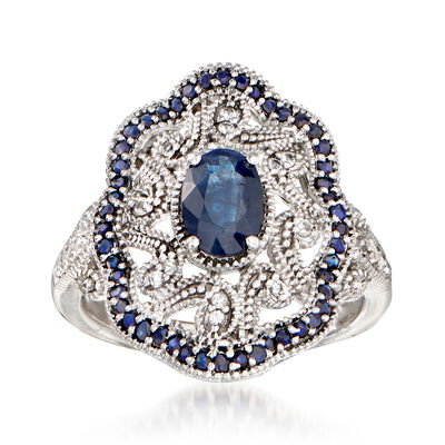 1.30 ct. t.w. Sapphire and .10 ct. t.w. White Topaz Scrollwork Ring in Sterling Silver