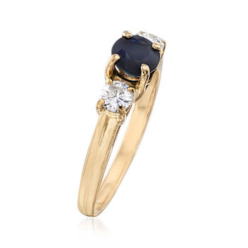 C. 1980 Vintage .75 Carat Sapphire and .40 ct. t.w. Diamond Three-Stone Ring in 14kt Yellow Gold. Size 6.5