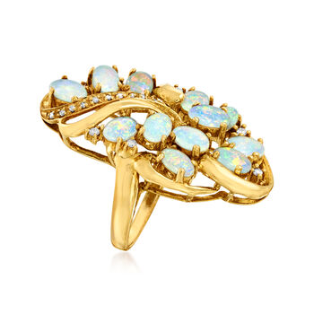 C. 1970. Opal, .19 ct. t.w. Ruby and .13 ct. t.w. Diamond Cluster Ring in 18kt Yellow Gold. Size 6.5