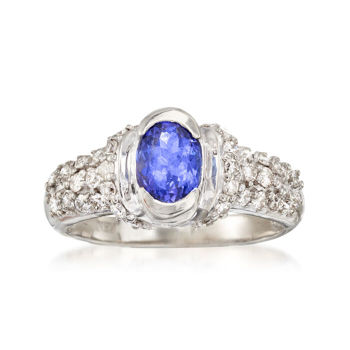 C. 1980 Vintage .95 Carat Tanzanite and .70 ct. t.w. Diamond Ring in 14kt White Gold. Size 6