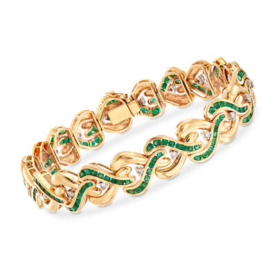 C. 1980 Vintage 5.25 ct. t.w. Emerald and .60 ct. t.w. Diamond Crisscross Link Bracelet in 14kt Yellow Gold