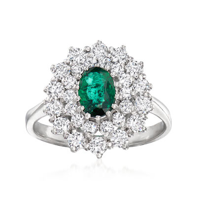 C. 1980 Vintage .60 Carat Emerald and 1.25 ct. t.w. Diamond Ring in 18kt White Gold
