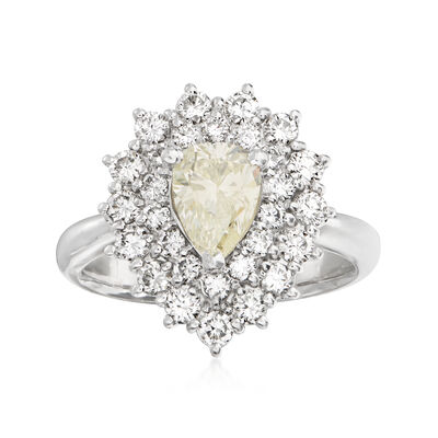 C. 1980 Vintage 1.00 Carat Yellow Diamond and 1.02 ct. t.w. White Diamond Ring in Platinum