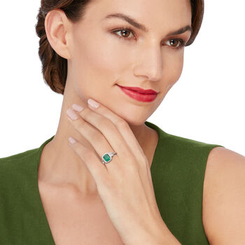 1.30 Carat Emerald and .30 ct. t.w. Baguette and Round Diamond Halo Ring in 14kt White Gold, , default